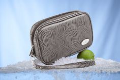 For the active woman.....Contempo by Cool-it Caddy.  Removable, freezable coolant packs keep your lipstick, skin care products, sunscreen, meds or protein bar icy cool for hours.  Perfect for golf, tennis, hiking, travel, the beach, etc.