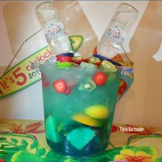 Tipsy Bartender Island Rum Punch Bucket (good bday idea)- blueberry juice, triple sec, island punch pucker schnapps liqueur, oranges, lemons, pineapples, pineapple juice, passion fruit rum, guava rum, pineapple rum, sweet & sour, smirnoff ice tropical fruit, kiwis, strawberries, limes