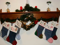 Cross stitch cuff Christmas stockings made from blue jeans