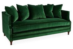 Tailored to perfection, this emerald sofa will be an ideal addition to any living space. Framed in American alder and upholstered in velvet, with ample goose-feather-and-down fill for long-lasting...