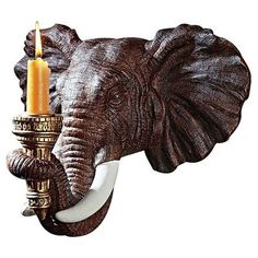 Bring adventuresome appeal to your dining room or library with this elephant-inspired candle sconce, showcasing ornate hand-painted details and a golden-fini. Elephant Love, Elephant Head, Elephant Stuff, Elephant Walk, Candle Sconces, Wall Sconces, Elefante Hindu, Elephant Home Decor, Wall Candle Holders