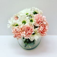 Daisies and pink carnations flower bowl arrangement