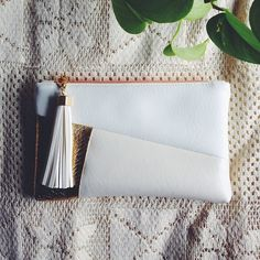 This Julia Clutch was just shipped off to a Canadian bride! Her color scheme is white and gold and I am so thrilled my work was able to fit into her dream wedding day! The ability to directly connect with strangers all over the world through a common visual language is #whyicreate! #etsy#estyshop#handmadeclutch#tassels#whiteandgold#weddingclutch#bridalclutch#love#vsco#vscocam