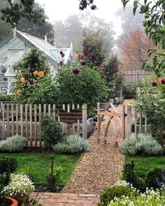 Dreamy garden with fence, gravel path and greenhouse garden cottage Jenny Rose, The Secret Garden, Secret Gardens, Garden Cottage, Farmhouse Garden, Farmhouse Homes, House With Garden, House Garden Design, Garden Homes
