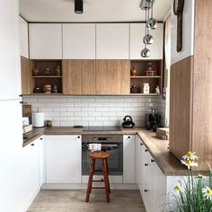 Looking to remodel your kitchen but don't know where to start? Don't worry, we have your back. With just a few simple tweaks, you can completely overhaul the look of … Wooden Kitchen, Kitchen Decor, Kitchen Design, Kitchen Ideas, Wall Racks, Kitchen Remodel, Designer, Small Spaces, Kitchen Cabinets
