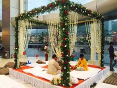 Looking for Green Floral Mandap with White and Red Roses? Browse of latest bridal photos, lehenga & jewelry designs, decor ideas, etc. Desi Wedding Decor, Wedding Hall Decorations, Marriage Decoration, Wedding Entrance, Wedding Mandap, Entrance Decor, Backdrop Decorations, Wedding Ideas, Wedding Goals