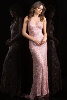 Gorgeous full length gown with thin straps and low open back, beautifully finished with a train and fully sequinced. The new colors for this last year favorite style are warm and intriguing, perfect for a Fall elegant night out. Fabric is 100% silk