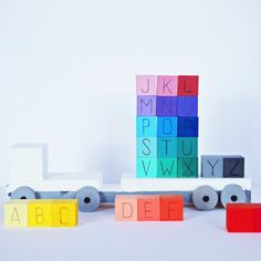 Make these cute Rainbow Wooden ABC Blocks and Truck for learning and fun!