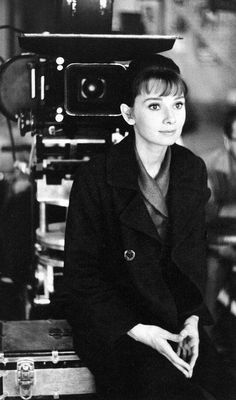 """Audrey Hepburn sits in front of a movie camera during a break in filming """"The Children's Hour"""" directed by William Wyler, photo by Bob Willoughby, 1961 Audrey Hepburn Movies, Audrey Hepburn Style, William Wyler, Shirley Maclaine, Acting Tips, Movie Camera, Roman Holiday, Film Inspiration, Julie Andrews"""