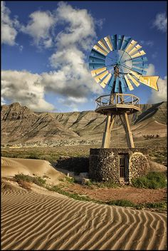"Windmill near the ""Caleta de Famara"" beach in Lanzarote, Canary Islands, Spain."