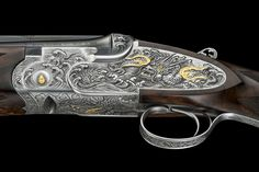 Beretta SO6EELL Premium over-and-under shotgun: a detailed view of the receiver engraved by Master Izumi
