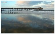 Tybee Island is a small barrier island with a three-mile-long Atlantic Ocean beach that's backed by sea oat-covered sand dunes. Stroll the south-end pier and pavilion and listen to the music of live b