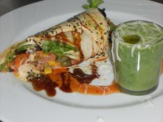 Starter Gourmet  - Chicken Wrap with a shot of a soupe vegetables.