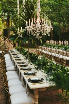 Long outdoor wedding table with greenery runner Tablescape Reception decor with hanging chandeliers Stylish Greenery Wedding in Maui Hawaii Perfete Outdoor Wedding Tables, Long Table Wedding, Wedding Reception, Outdoor Weddings, Wedding Seating, Wedding Table Planner, Wedding Planning, Wedding Ideas, Event Planning
