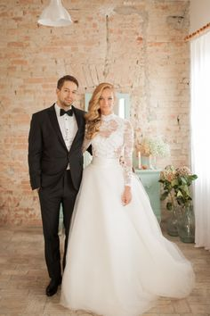 High neck long sleeve lace wedding dress + tulle overskirt: http://www.stylemepretty.com/2015/11/30/50-elegant-gowns-that-will-never-ever-go-out-of-style/