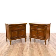 This pair of modern neoclassical inspired nightstands are featured in a solid wood with a gorgeous light cherry finish. These end tables have carved tapered legs, 1 drawer and a large interior cabinet. Eye catching bed side tables with plenty of storage! #midcenturymodern #dressers #nightstand #sandiegovintage #vintagefurniture