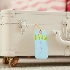 Love this idea. Turning an old suitcase into a place to store sheets under the bed. Just add wheels.