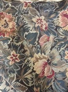 Large floral print on darker background upholstery fabric (6 yards) on bolt.