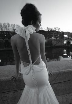Backless Wedding Dress Gown - Be daring with this playful interpretation of a backless wedding dress with plait and bow detail.