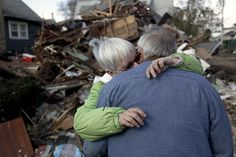 Battered By Storm, Staten Islanders feel forgotten--Sheila and Dominic Traina hug in front of their home which was demolished during Superstorm Sandy in Staten Island, N.Y., Friday, Nov. 2, 2012. Mayor Michael Bloomberg has come under fire for pressing ahead with the New York City Marathon. Some New Yorkers say holding the 26.2-mile race would be insensitive and divert police and other important resources when many are still suffering from Superstorm Sandy.
