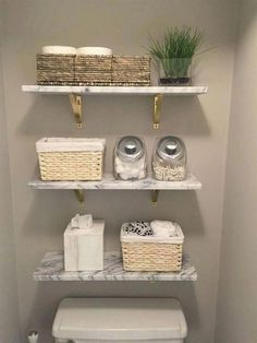 Marble wall-mounted shelves from wood shelves and toilet paper in a basket. Bathroom Shelves, Bathroom Organization, Bathroom Storage, Bathroom Interior, Modern Bathroom, Small Bathroom, Beautiful Bathrooms, Bathroom Cabinets, Parisian Bathroom