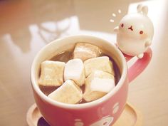 Molang likes his cocoa with marshmallows.