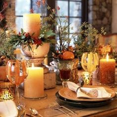 small pumpkins or apples setting on candle holders Harvest dinner party