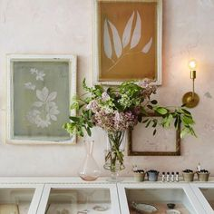 """One side of the shop has beautifully textured soft pink plaster walls. These screen print frames depicting floral silhouettes are the perfect offset to such subtle walls and soft color. """"For some reason the name, The Golden Carrot, instantly made me think of the illustrations in a Beatrix Potter storybook,"""" Nicky says. """"I envisioned a space that had a soft, enchanting innocence to it, and I wanted people to feel transported when they stepped inside."""""""