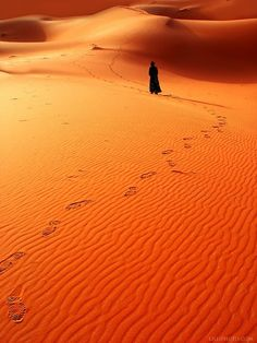 The Sahara - you are not alone, judging by the footsteps in the sand. ;-)