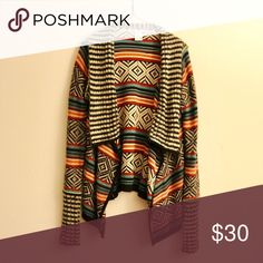 Tribal Print Cardigan Soft knitted tribal print cardigan. Open front with a stripe knot lapel/collar. Very warm and drapes to the body. Great for a styling winter! American Rag Sweaters Cardigans