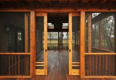 Decorative barn doors also work very well for porch partitions.  High traffic area?  Make it easy to get in and out with a decorative barn door.  www.decorativewoodworkathome.com