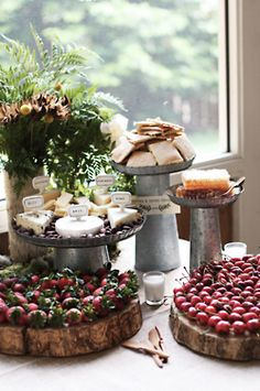 berries on rustic wood slice platters, cheese trays on antique pieces (think the French provincial feel of Belly in ATL)