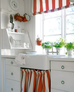 "Idea for dish rack in a small kitchen!  Could have more than one ""shelf"" above it, if you have the space, so you have place for cups/glasses and hang it a little higher-put cup hooks up under it, to hang coffee mugs from!"