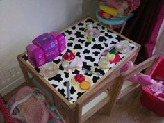 Re-covered table with fablon. This is a great way to jazz up kids furniture. Looks funky and affordable. Visit www.vinylwarehouse.co.uk for this Moo Cow design. #be_inspired #inspire_others #vinyl #Fablon