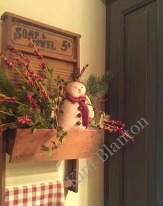 Old Washboard Box...stuffed with pine & a prim snowman.