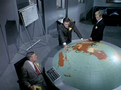 "I loved ""Man From U.N.C.L.E."" as a teenager, but was unaware that each episode was packed with Illuminati symbolism and predictive programming.  Now that I have the DVDs, it is eye-opening to see all the ""clues"".  For example, the half-""globe"" in Mr. Waverly's office was a flat-earth map (as was the large map hanging on the wall in later episodes)!"