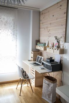 love this wood wall in the work space.