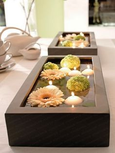 floating flowers and candles, romantic center pieces