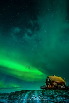 Norway.  House of the rising aurora (via Deryk Baumgärtner)