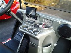 This golf cart has a flat panel, touch screen dvd system