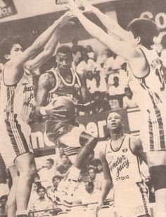 Kenny Travis of the San Miguel Beermen looking for the layup against the Purefoods TJ Hotdogs defenders in action of the 1992 PBA Third Conference. Defenders, Hot Dogs, Conference, Third, Basketball, Action, Seasons, Retro, San Miguel