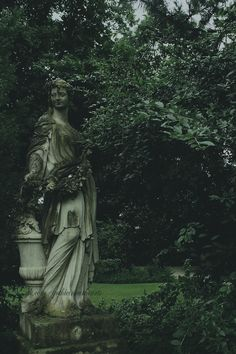 Lovely statue deep in the woods. http://fawndoeyou.tumblr.com/post/82885060645