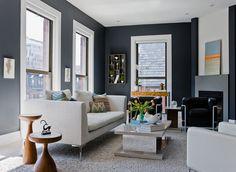 For inspiration: dark blue living room walls in this apartment make a perfect backdrop for vibrant batik decorative pillows accessories. #batik #pillow #pattern #design #inspiration #art #culture #fabric #interiordesign