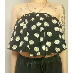 sunflower tube top! black and yellow flowy sunflower tube top. elastic lined inside for the boob area to stay in shirt lol size medium, can fit a small. worn a few times. looks so cute with jean shorts and sandals. Tops Crop Tops