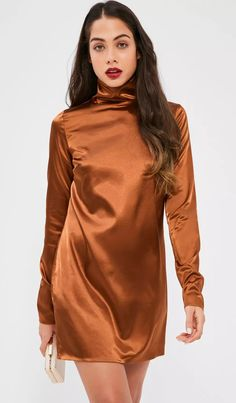 042d58980e4 Take it to the top this party season in this toffee brown mini dress -  featuring a high neck