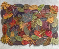 Knitting Pattern for Forest Floor Rug - 6 leaf shapes sewn together to make a rectangular rug. Great stashbuster! One of the patterns in Knitting Rugs: 39 Traditional, Contemporary, Innovative Designs. Available in Kindle and Paperback from Amazon http://amzn.to/2p7V5Rh tba stashbuster botanical