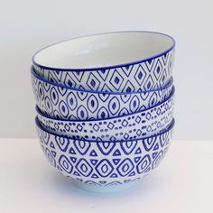 Beautiful blue and white porcelain bowls.Designs (from top to bottom of image): Ikat Oval Pips ArrowThe vivid blue print patterns set against the white pottery create striking designs, making these beautiful plates both decorative and functional. Perfect size for pasta, noodles and soups. A modern twist on the traditional blue and white pottery style, these bowls look great displayed on an open shelf or kitchen dresser.PorcelainHeight 9cm Diam 18.5cm