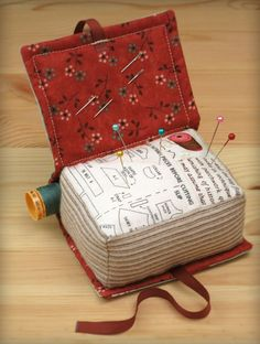 Book Pincushion--this is cute. I like the pocket for holding thread.