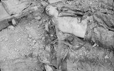 The body of a German soldier from the 25th Panzer Grenadier Regiment at Malon, 9 July 1944.