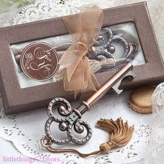 """Our Vintage Skeleton Key Bottle Opener Wedding Favors will truly captivate your guests at your vintage themed wedding! With an aura of romance and mystery, these bottle opener wedding favors are the perfect way to say """"thank you"""" to your guests for sharing in your special day. With charming beauty, these vintage wedding favors will wow your guests with their elegance and style. Open the door to love with these enchanting vintage key bottle opener wedding favors! Each alluring keychain measur..."""